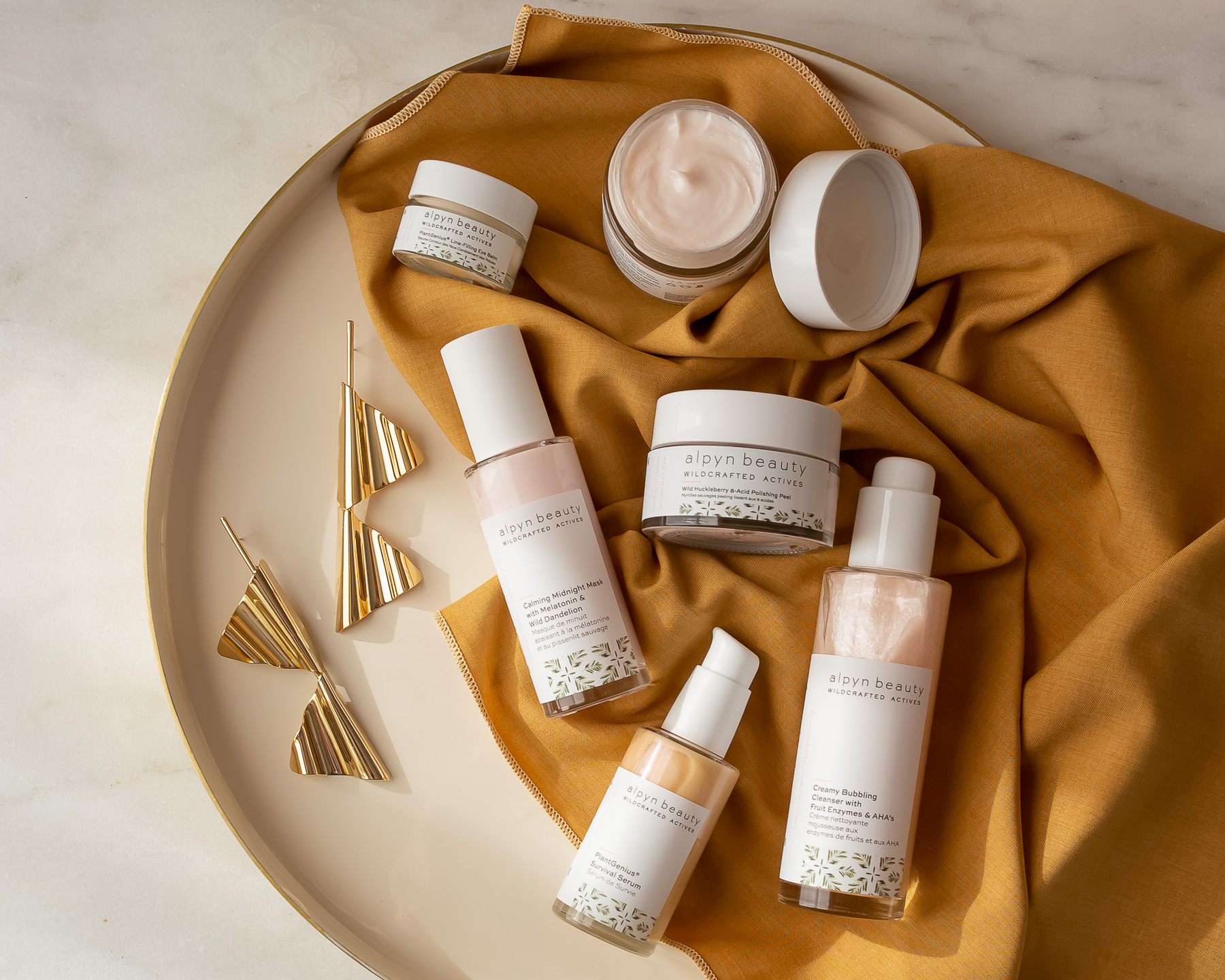 skincare and jewelry flatlay photo by emily farris sidework content studio